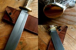 Large camp knife in edge quenched carbon steel, brass and stag